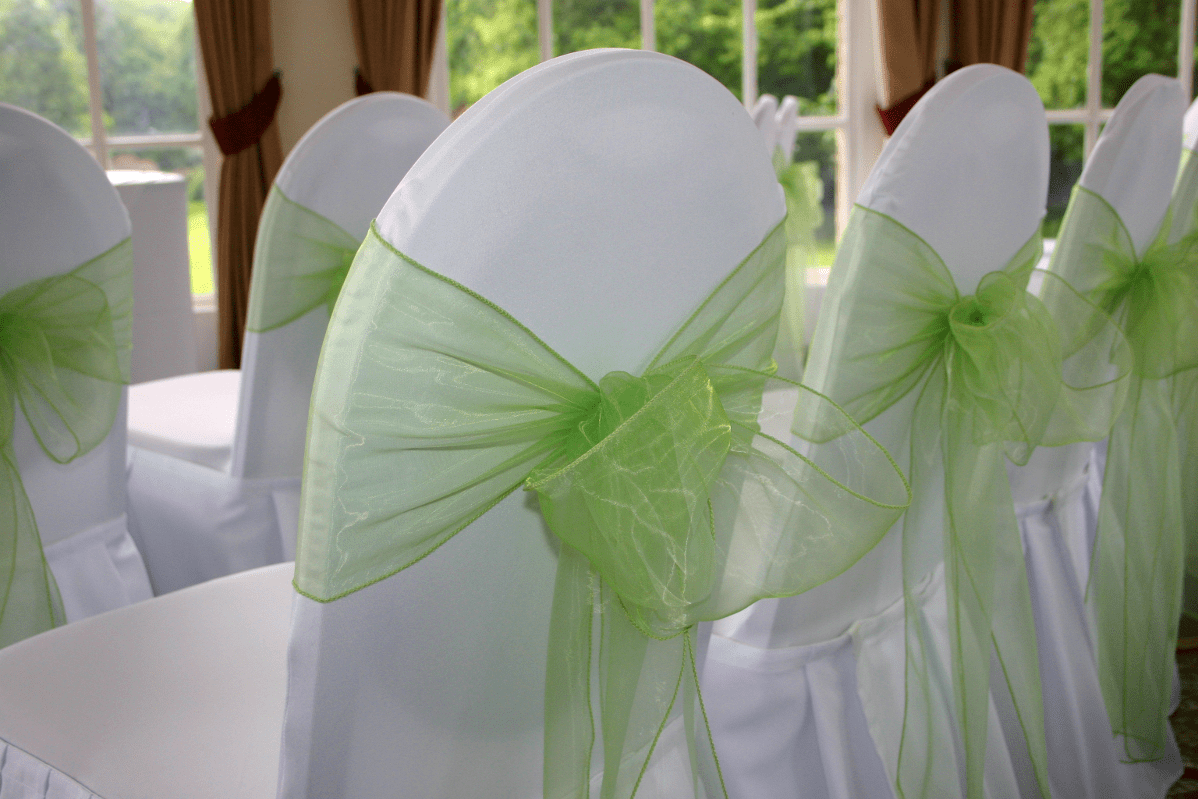 green chair covers roman leg raises vs hanging and sashes for weddings in hertfordshire