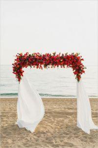 Red floral arch | WeddingElation