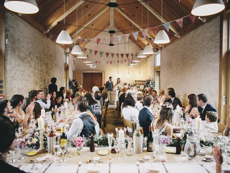 Designed to evoke romance, fall in love with these rustic UK barn venues offering quirky outbuildings, festival yurts and miles of coastal country views!