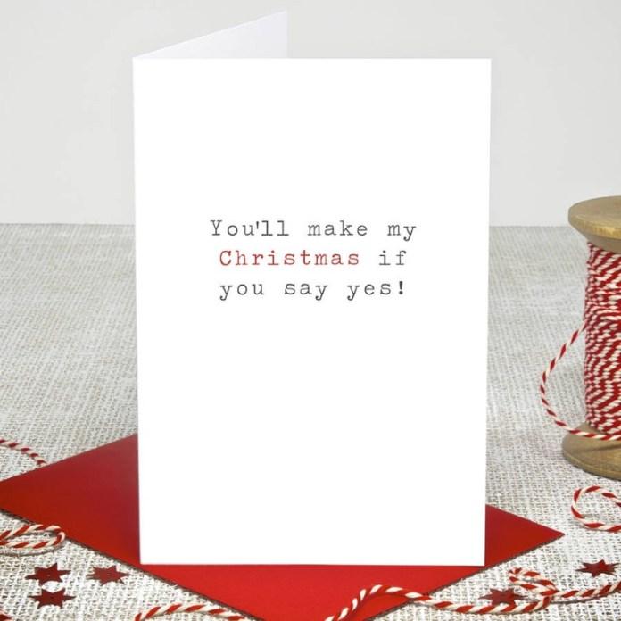 "christmas-card-proposal-ideas ""width ="" 800 ""top ="" 800 ""srcset ="" https://i0.wp.com/www.weddingideasmag.com/wp-content/uploads/2019/11/christmas-card-proposal-ideas.jpg?w=696&ssl=1 800w, https://www.weddingideasmag.com/wp-content/uploads/2019/11/christmas-card-proposal-ideas-150x150.jpg 150w, https://www.weddingideasmag.com/wp-content/uploads /2019/11/christmas-card-proposal-ideas-300x300.jpg 300w, https://www.weddingideasmag.com/wp-content/uploads/2019/11/christmas-card-proposal-ideas-768x768.jpg 768w , https://www.weddingideasmag.com/wp-content/uploads/2019/11/christmas-card-proposal-ideas-650x650.jpg 650w ""sizes ="" (max-width: 800px) 100vw, 800px ""/> <figcaption id="