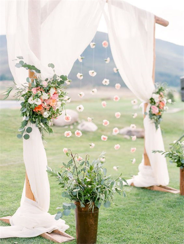 Spring flowers and greenery Outdoor Pastel Keystone Colorado wedding arch ideas