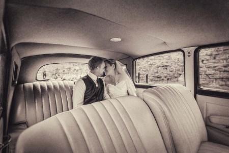 Bride and groom in weding car