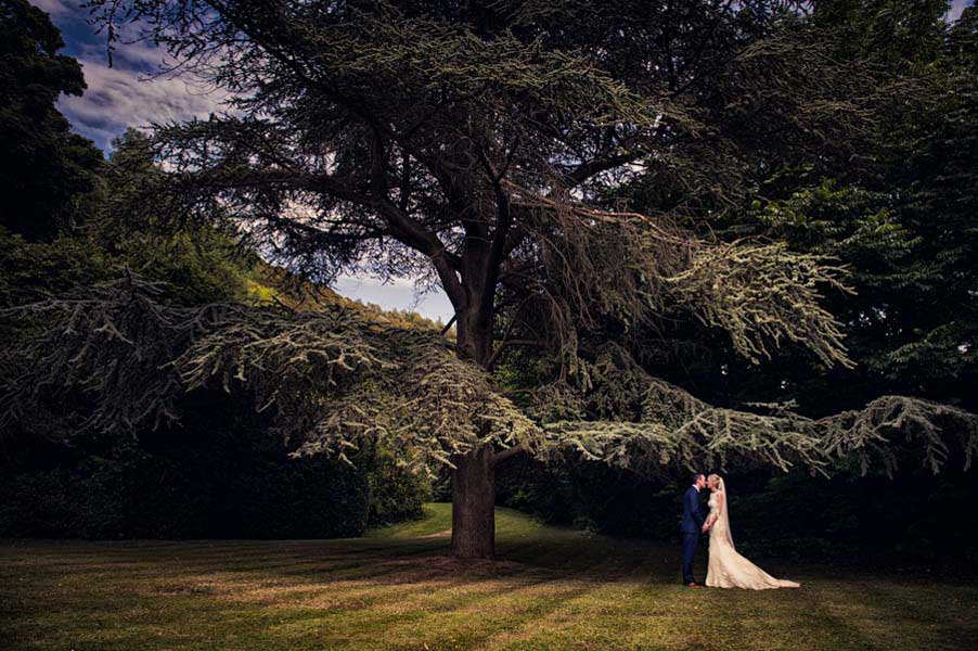 bride and groom in a beautiful english garden