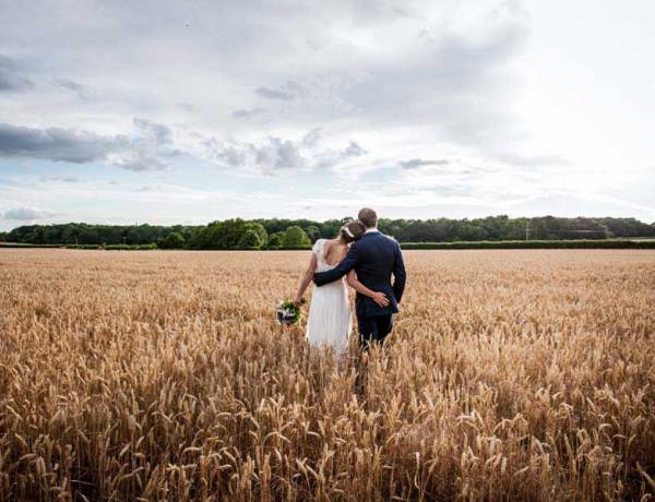 bride and groom in a wheat field
