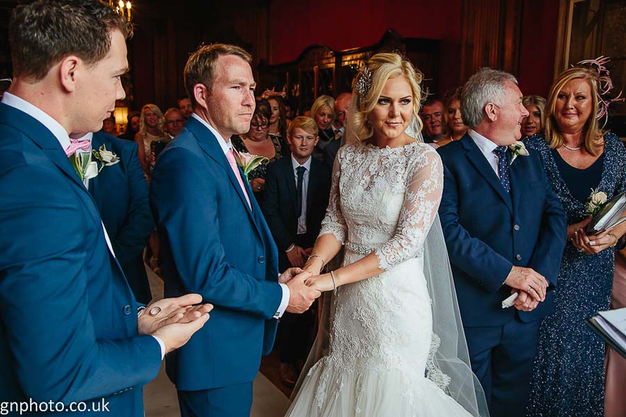 bride and groom holding hands Thornton Manor