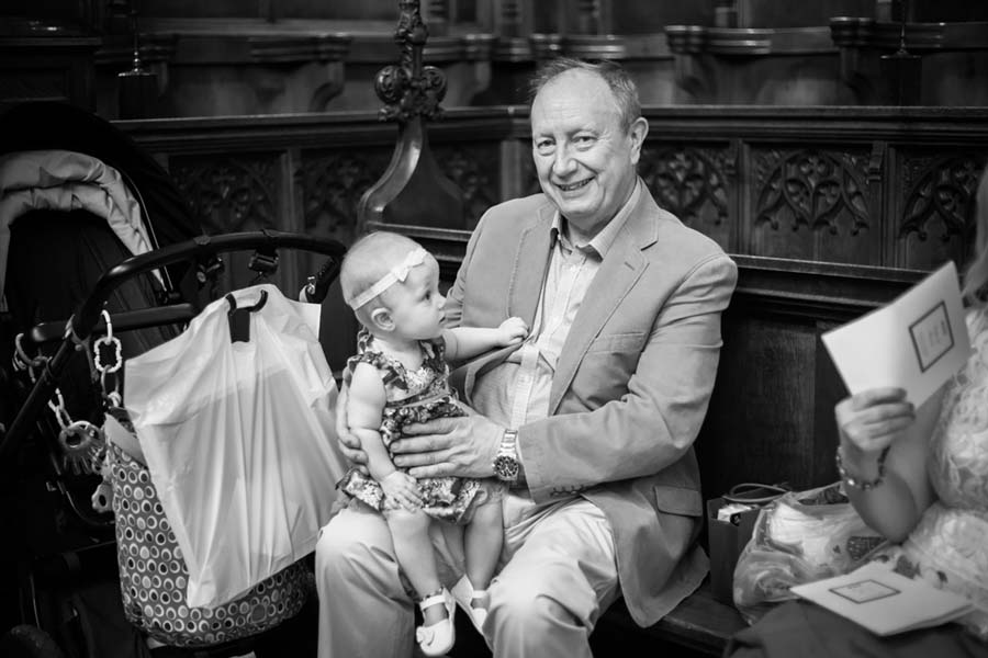 Father of the bride holding baby