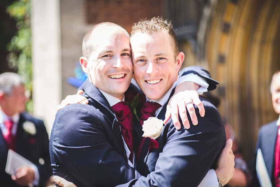 groom and best man hugging