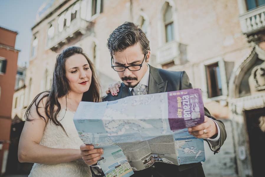 bride and groom read map