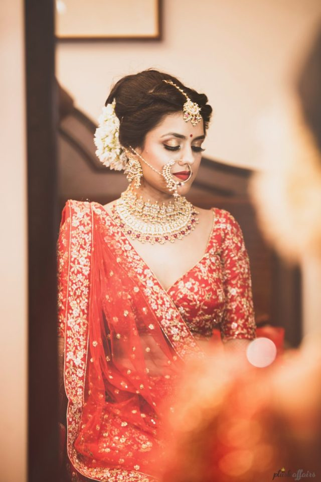 real wedding in Bhopal by Plush Affairs photography-bride had embroidered wedding date and names on her wedding lehenga
