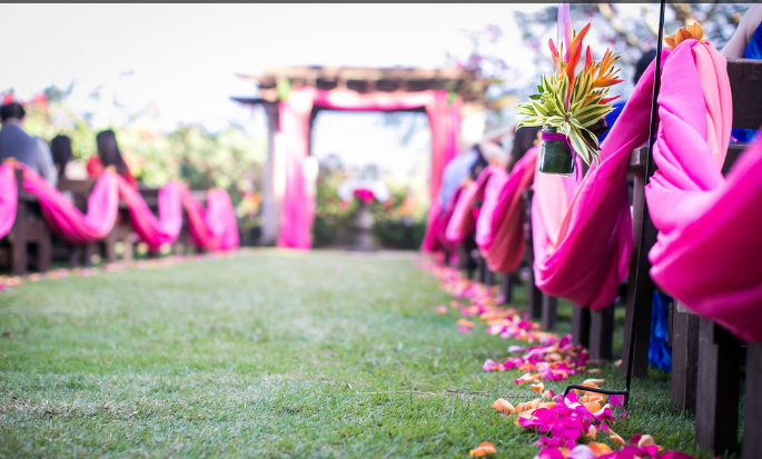 draped fuschia fabric at Siesta Alegre wedding ceremony area