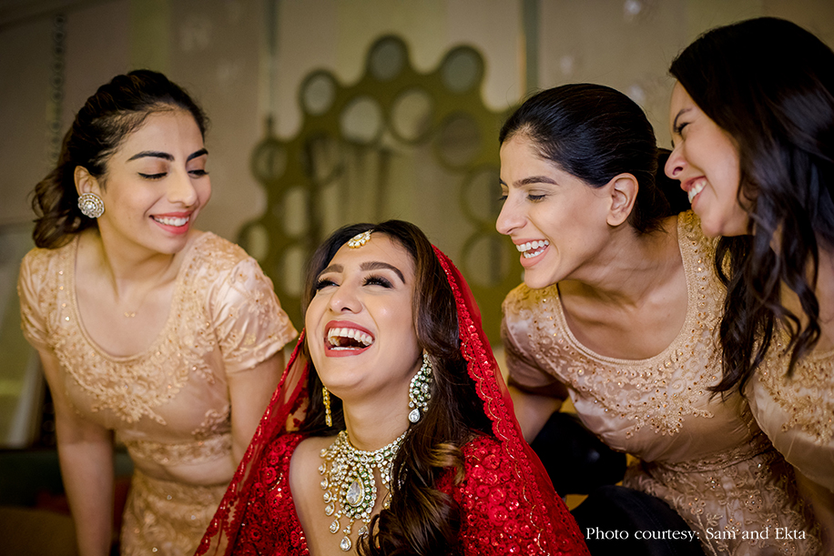 Bride in Red Sabyasachi lehenga at Oman