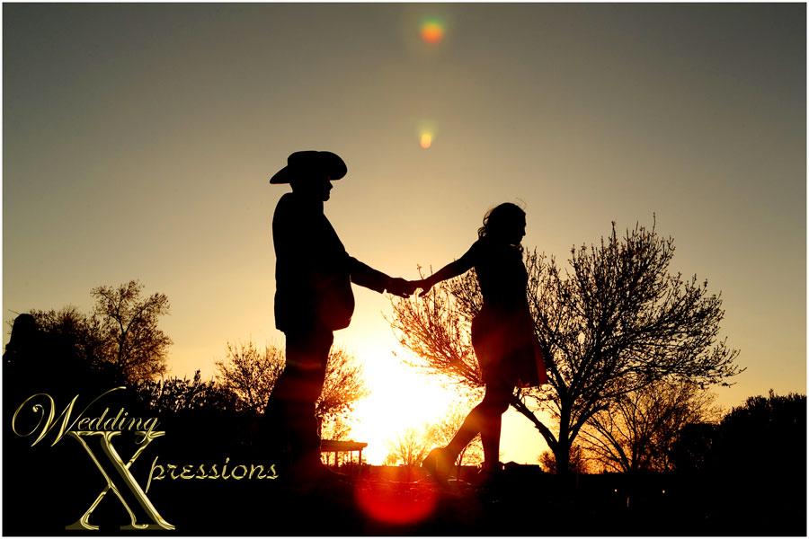sunset cowboy engaged girl