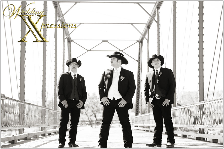 groomsmen on bridge