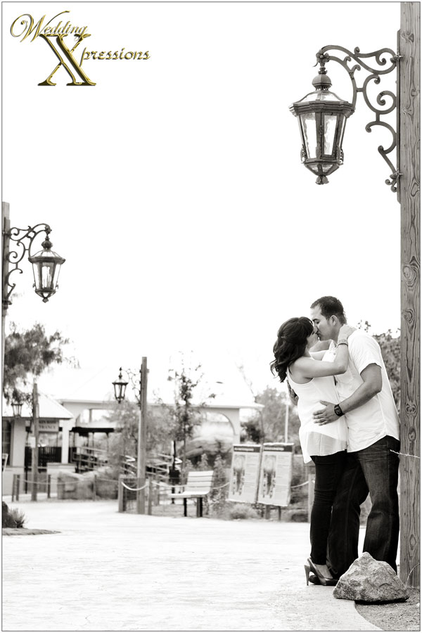 engagement kiss next to light post