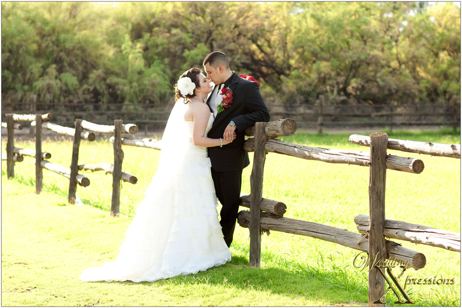 wedding photography of couple on fence