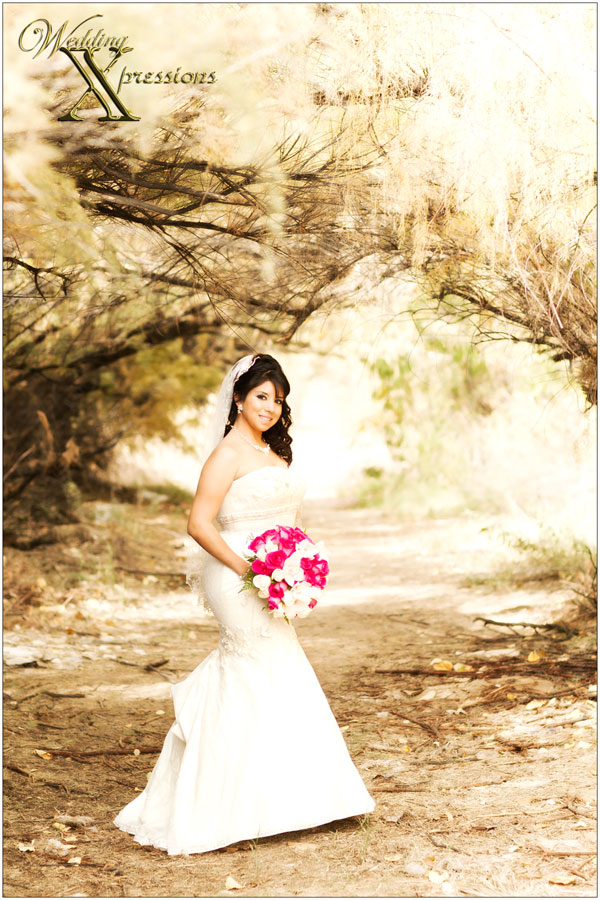 bride with pink flower bouquet