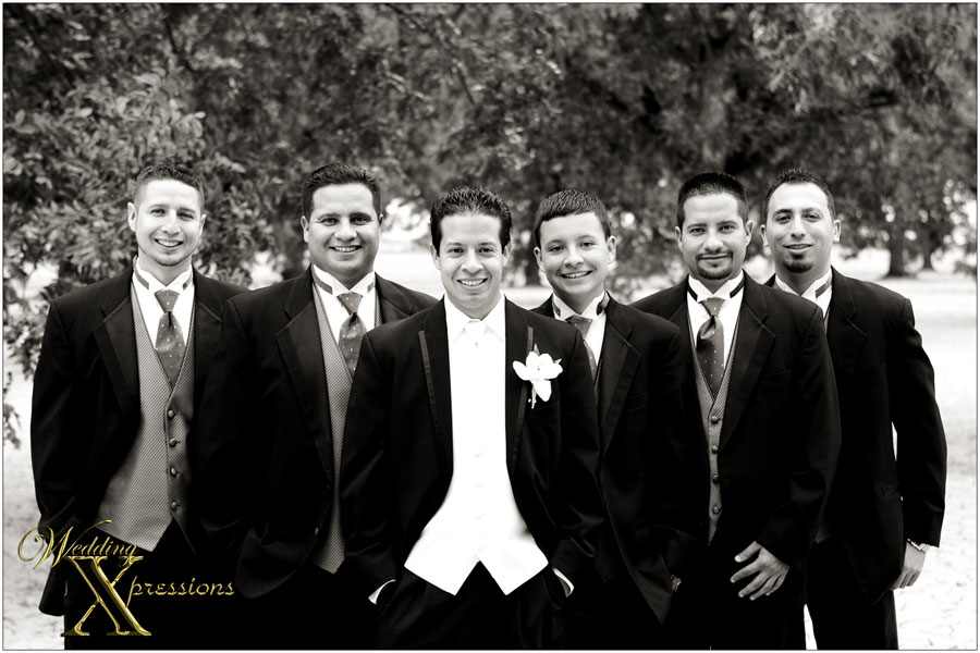 black and white photo of grooms men