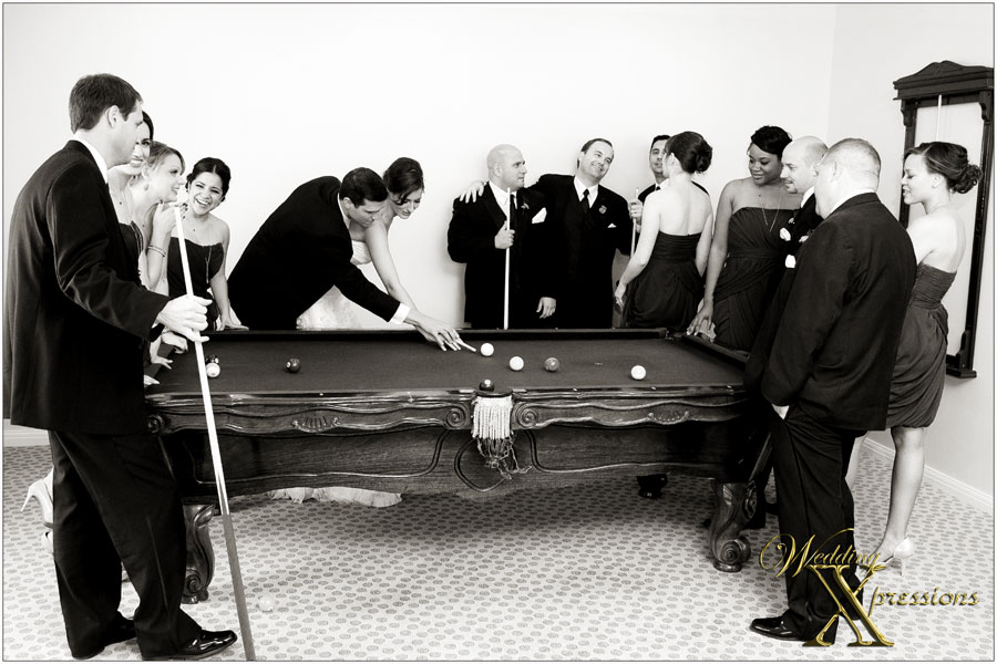 bridal party playing pool on wedding day