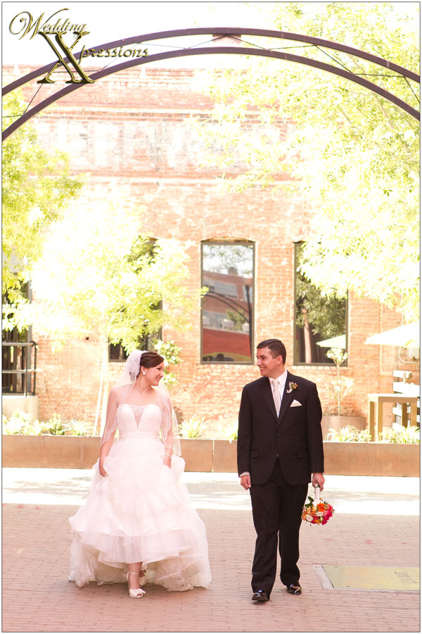 bride and groom taking a stroll in their wedding day