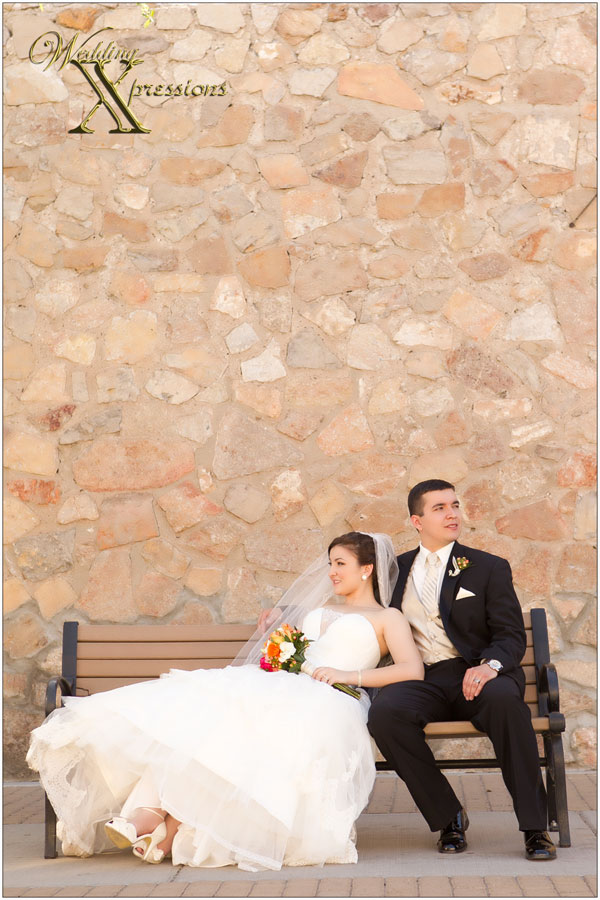 bride and groom on a bench
