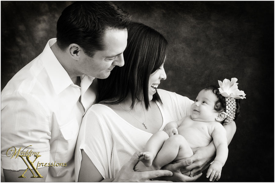 baby smiling with mom and dad