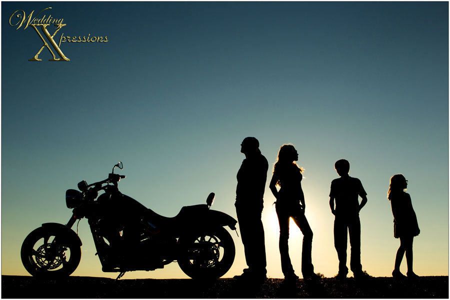family with motorcycle silhouette
