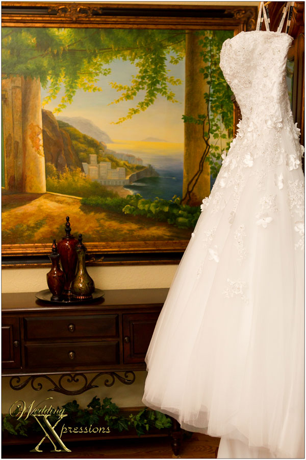 white wedding dress with painting in the background