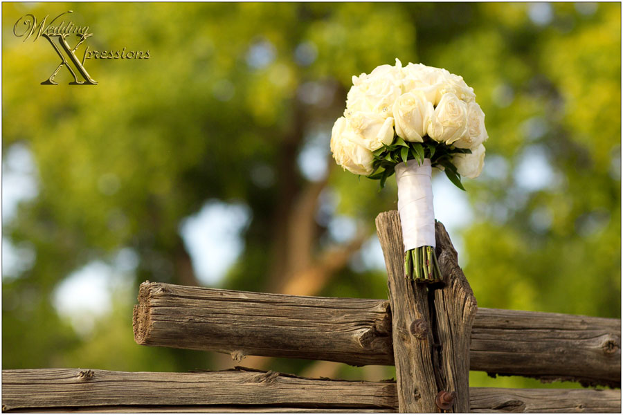 wedding bridal bouquet on wooden fence