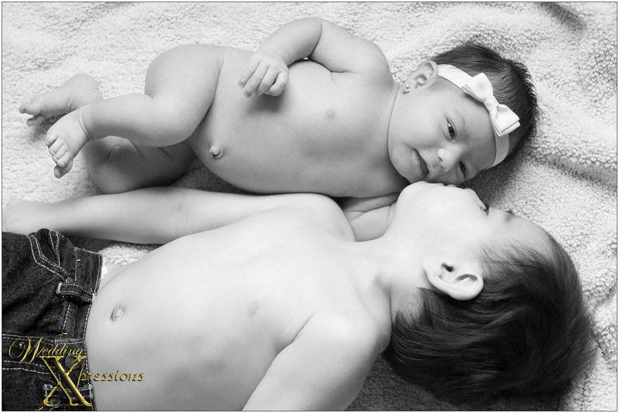 big brother and newborn sister