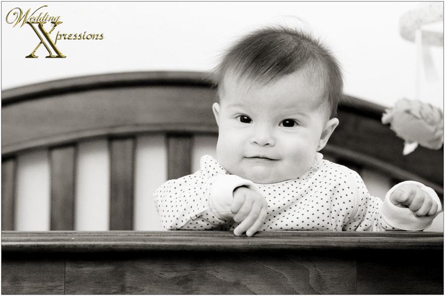 Madeline in her crib