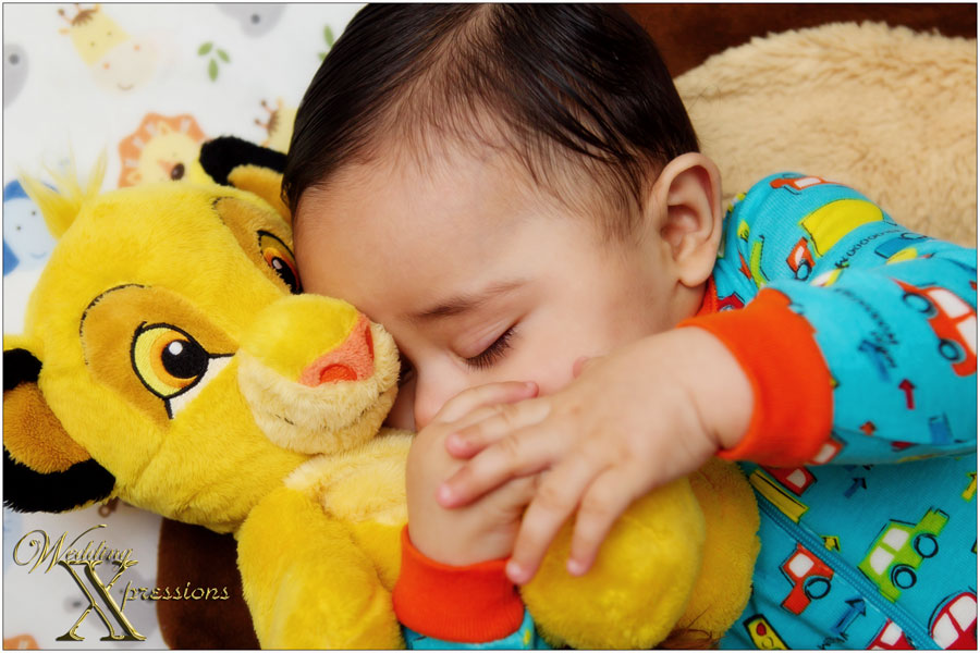 baby sleeping with Simba