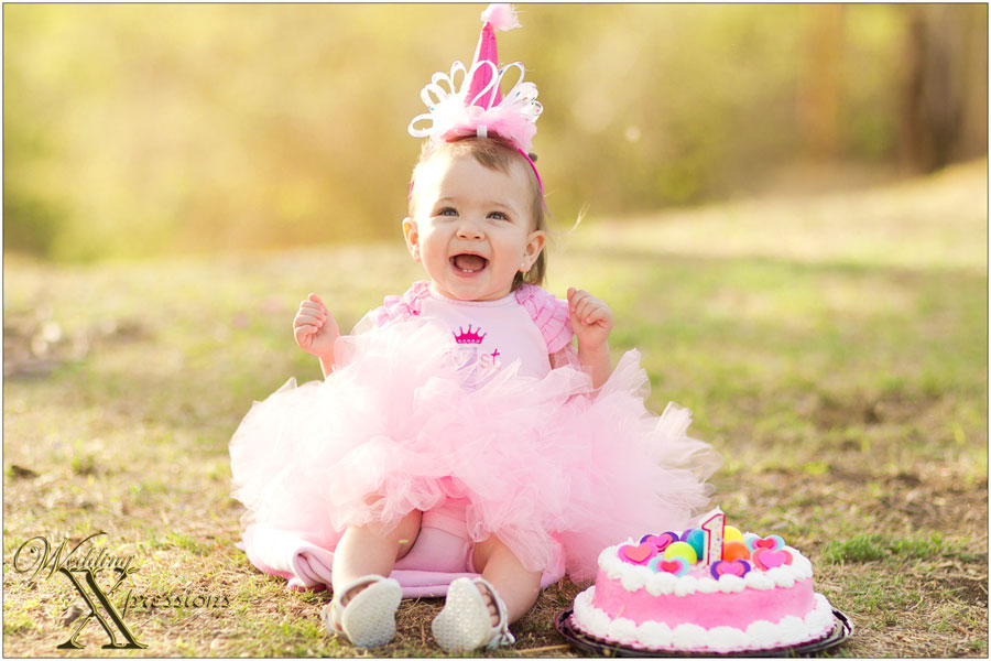 baby with cake and hat