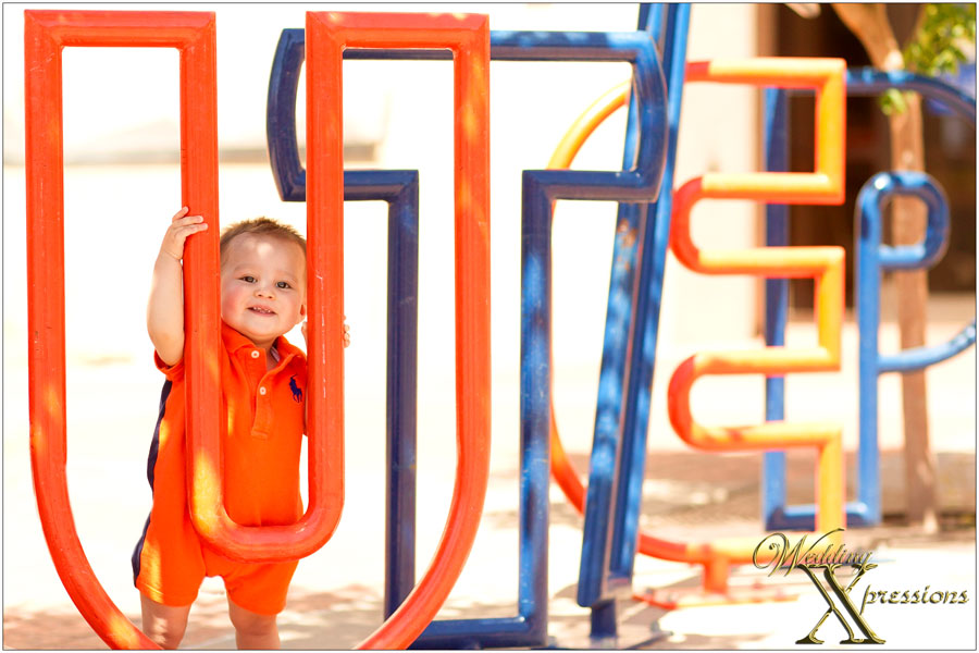 baby with UTEP sign