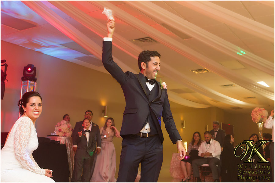 garter toss in El Paso wedding. Photography by Wedding Xpressions