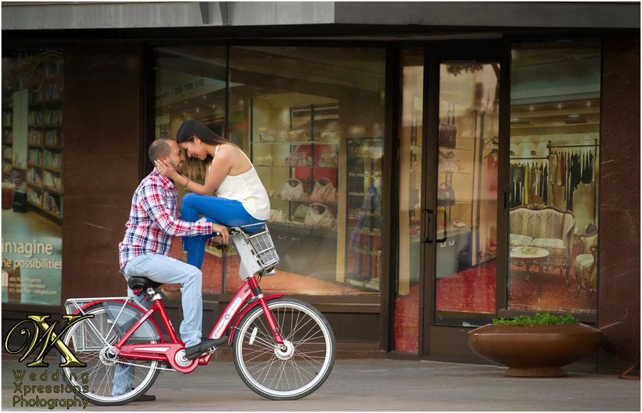 engaged couple on a bike