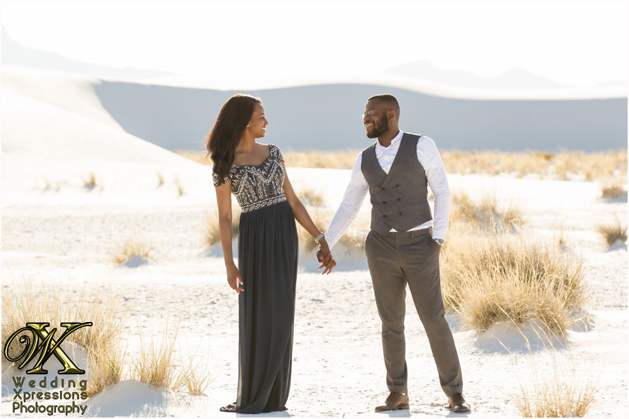 engaged couple together at White Sands