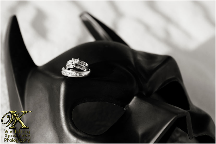 engagement rings on Batman mask