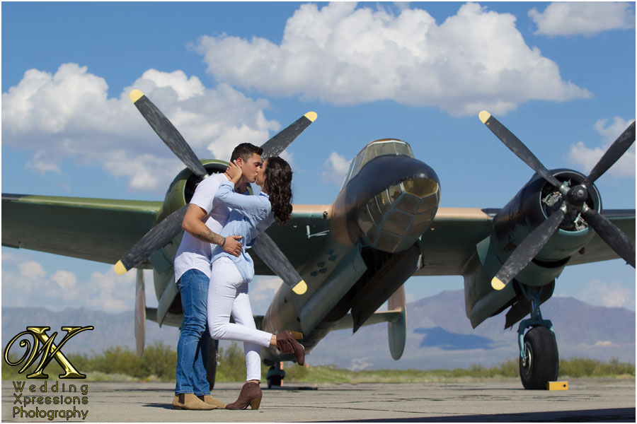 Engagement session couple with airplane