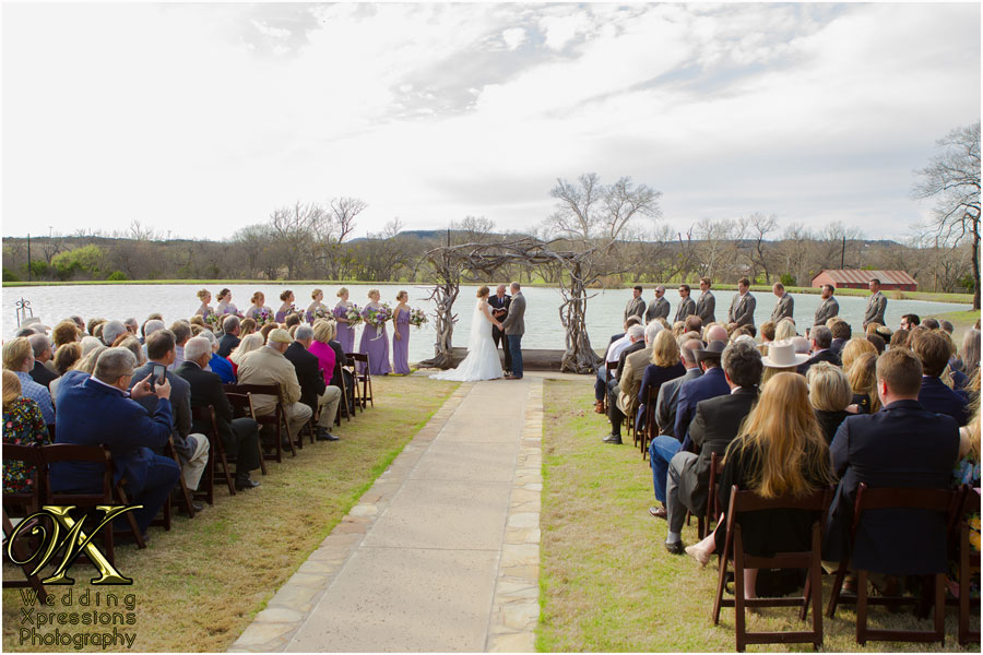 wedding ceremony by lake at Thistle Springs Ranch