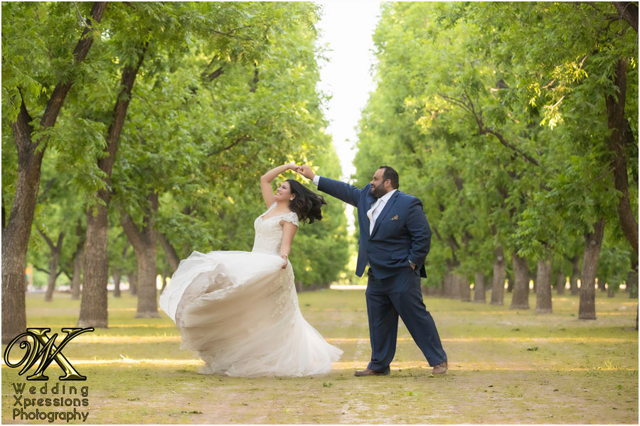 bride and groom dancing outdoors by Wedding Xpressions