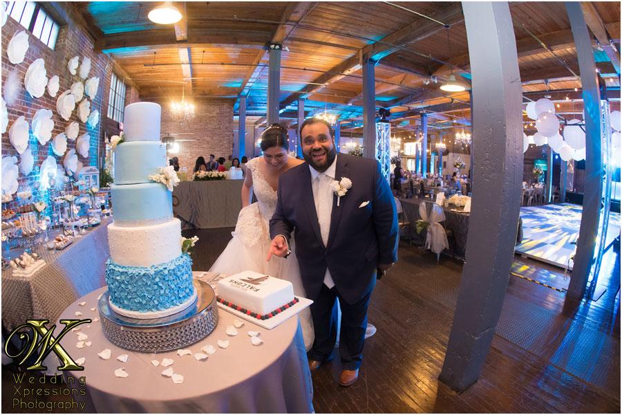 groom viewing grooms cake