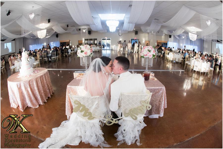 wedding kiss at Grace Gardens