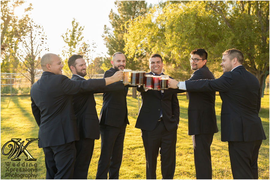 groomsmen toasting with beer mugs