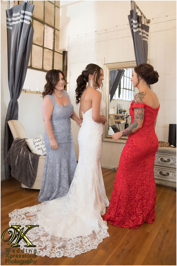 bride getting ready with mom and maid of honor