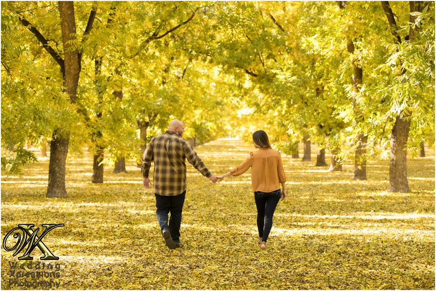 fall trees during engagement session in El Paso