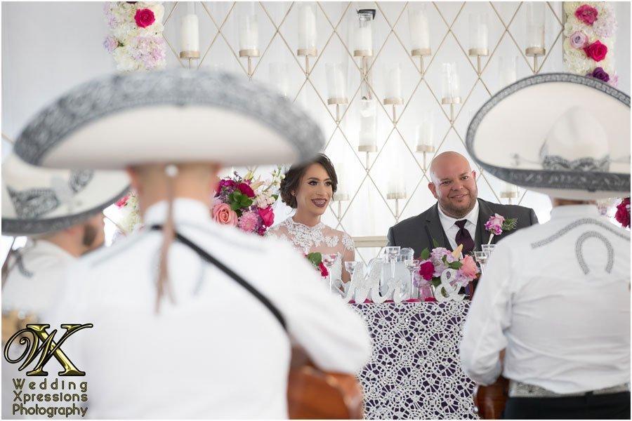wedding couple listening to mariachi in El Paso