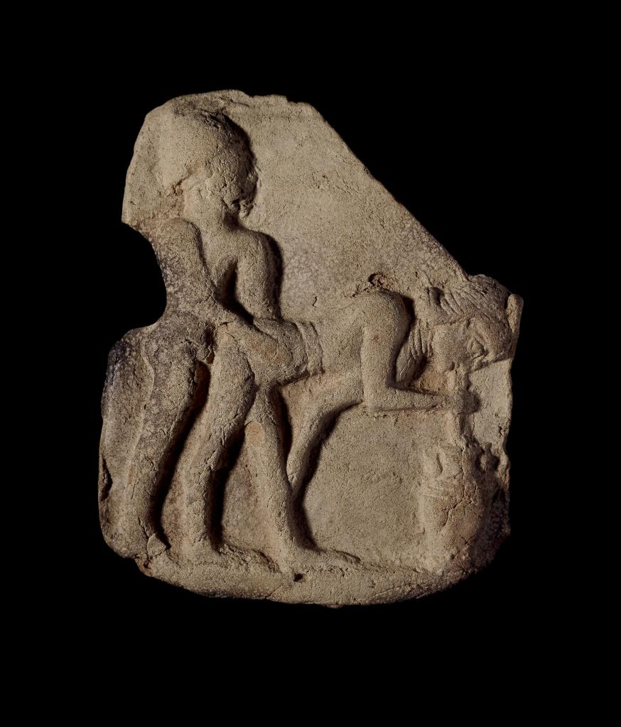 terracotta plaque showing intercourse between a man and a woman