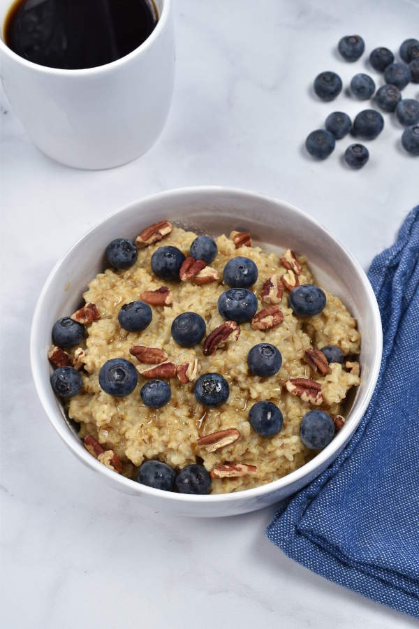 Instant Pot Steel Cut Oats is an easy healthy breakfast, great for meal prep but also doable on a weekday morning. Once you start the pressure cooker, this recipe is completely hands off. Steel cut oats cook perfectly with only 4 minutes under pressure—no need to stand by the stove and stir constantly. With so many topping options, this breakfast never gets boring.