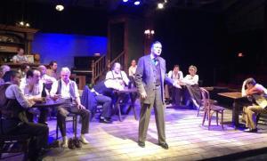 Hickey (Dana Hart) 'inspires' his fellow saloon regulars.