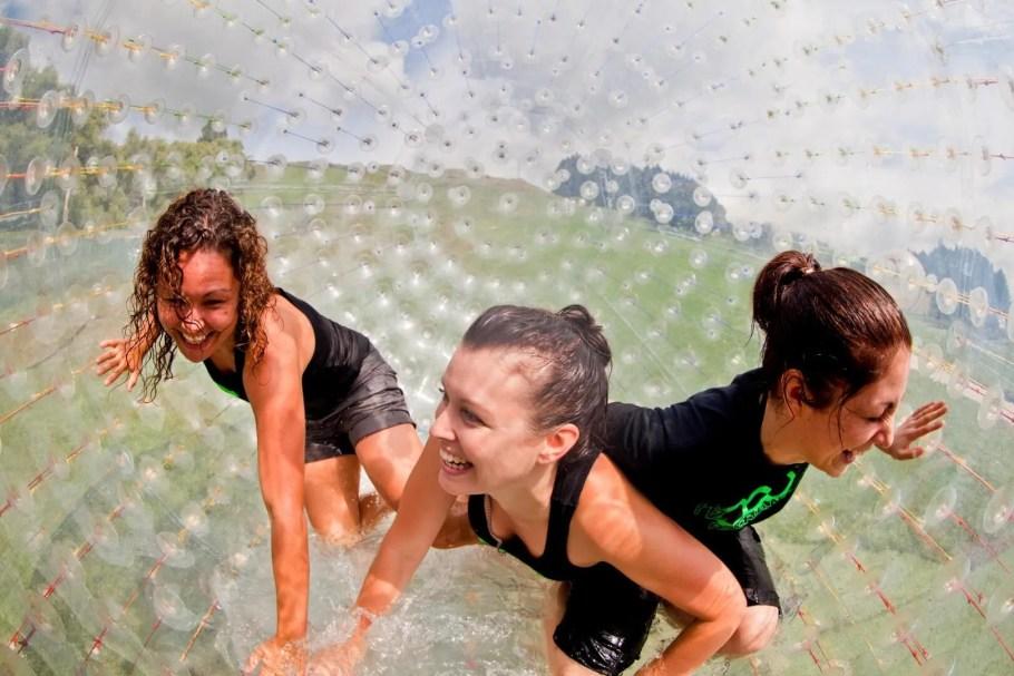 3 girls inside a zorb at zorbing rotorua